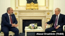 RUSSIA - Armenia's Acting Prime Minister Nikol Pashinian (L) and Russia's President Vladimir Putin meet at the Kremlin, Moscow, July 7, 2021.