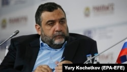 "The report says there is no ""definitive evidence"" Ruben Vardanyan knew of the scheme, but that his signature was on one document in which he purportedly gave a loan to a company that was part of a network of the operation."