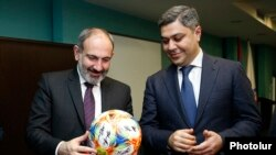 Armenia - Prime Minister Nikol Pashinian (L) and National Security Service Director Artur Vanetsian visit the Football Academy in Yerevan, March 25, 2019.