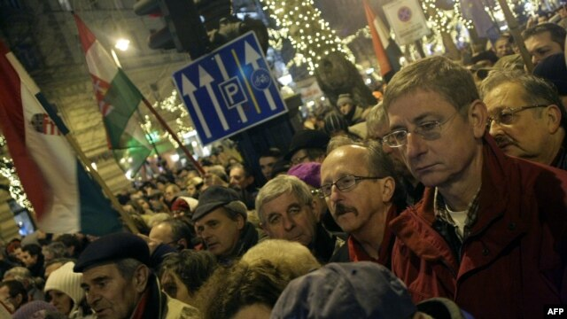 Ex-Prime Minister Ferenc Gyurcsany (right front) joined tens of thousands of demonstrators in front of the opera building in Budapest on January 2 to protest the recent legislative changes.