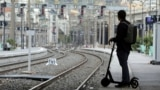 FRANCE -- A commuter stands on a platform at Nice train station in Nice during a nationwide strike by French SNCF railway workers, France, April 3, 2018.