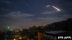 FILE PHOTO:A picture taken early on January 21, 2019 shows Syrian air defence batteries responding to what the Syrian state media said were Israeli missiles targeting Damascus.