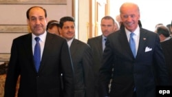 Despite a recent visit from U.S. Vice President Joe Biden (right), Iraqi Prime Minister Nuri al-Maliki has shown no inclination to interfere in the vetting commission's banning of candidates.