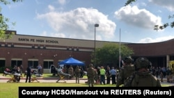 Law enforcement officers respond to the shooting at Santa Fe High School in Texas on May 18.