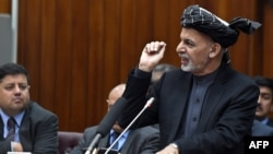 Afghan President Ashraf Ghani speaks as he introduces his cabinet nominees to parliament in Kabul on January 20.