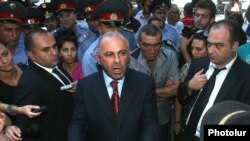 Armenia - Police chief Alik Sargsian talks to protesters outside the government building in Yerevan, 1Sept2011.