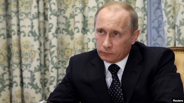 Prime Minister Vladimir Putin takes part in a video conference in response to the March 29 attacks.