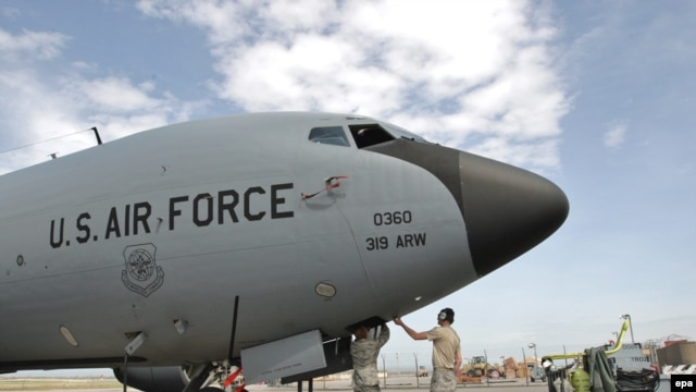 U.S. soldiers inspect military planes at the Manas air base in Kyrgyzstan.