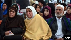 Relatives of 27-year-old Farkhunda, who was beaten to death by a mob, attend a hearing in a court in Kabul on May 6.