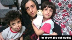Iranian human rights activist, Narges Mohammadi with her children Ali (center) and Kiana
