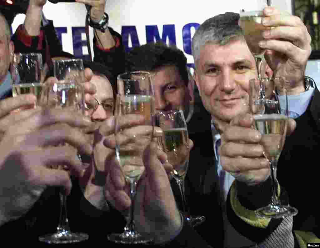 Members of the Democratic Party of Serbia celebrate Djindjic's election victory in Belgrade on December 24, 2000. He took office as prime minister one month later.