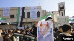 Demonstrators rally against Syrian President Bashar al-Assad after Friday Prayers in Talbiseh, Syria