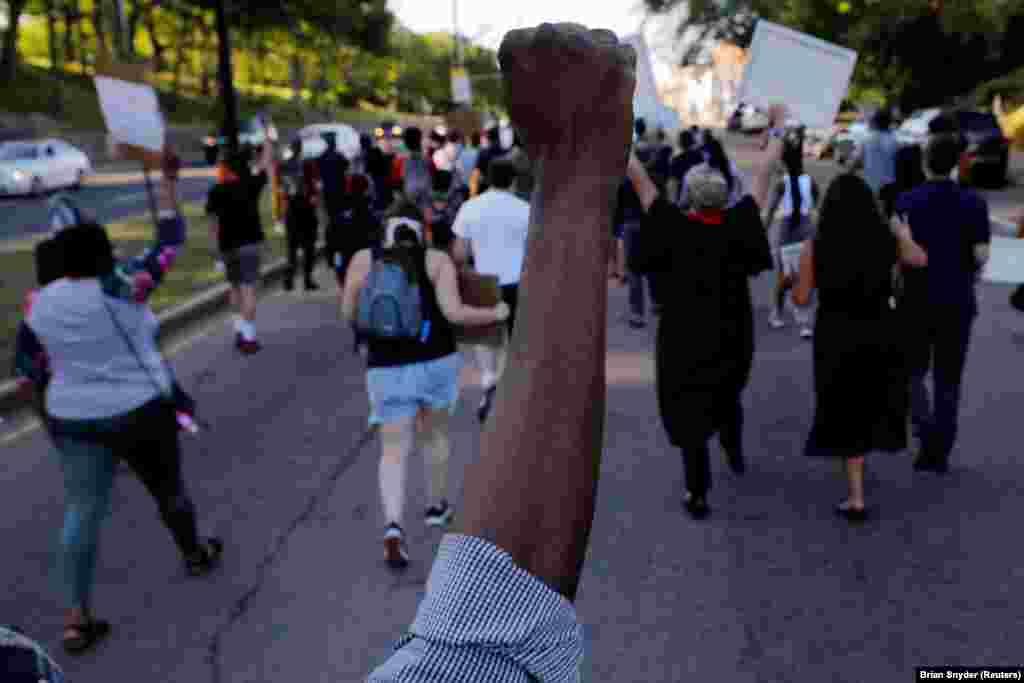 Marchers take part in a Juneteenth Awareness Walk to demonstrate against racial inequality in the aftermath of the death in Minneapolis police custody of George Floyd, in Boston, Massachusetts, U.S., June 18, 2020. REUTERS/Brian Snyder