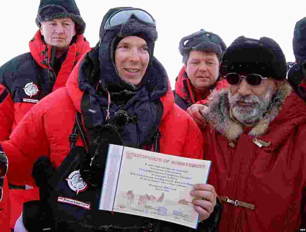 North Pole -- Prince Albert II of Monaco holds the sertificate confirming that he reached the geographical North Pole, Sunday 16 April 2006
