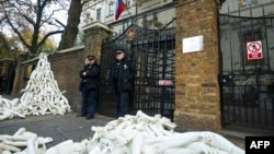 Structures made from white mannequin limbs were piled outside the Russian Embassy in London by protesters on November 3.