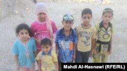 اطفال يحتفلون بالعيد في الناصرية