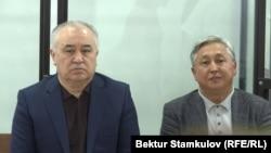 Omurbek Tekebaev and Duishonkul Chotonov in a Bishkek courtroom.
