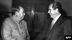 Chinese President Mao Zedong (left) shakes hands with U.S. President Richard Nixon at their meeting in Beijing in February 1972, one year after Zhuang Zedong's daring personal overture.