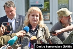 Lawyer Olga Mikhailova told journalists outside the hospital that she believes Navalny was poisoned.