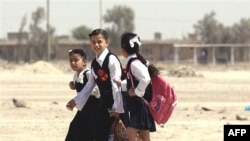 Students walk home from class in Tikrit, northwest of Baghdad. The lowest rate of primary enrollment in Iraq is among rural girls. (file photo)