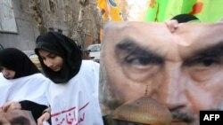 Iranian students invoke the Islamic Republic's late founder, Ayatollah Ruhollah Khomeini, at an anti-Israel rally in Tehran on January 4.