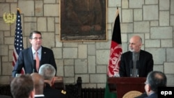 U.S. Secretary of Defense Ashton Carter (L) and Afghanistan's president, Ashraf Ghani, talk with journalists during a joint press conference in Kabul on February 21.
