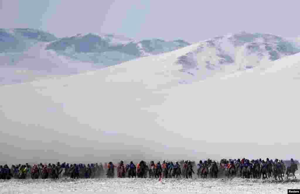 Riders attend a spring horse-racing event in Tsagaan Khutul, outside of Ulan Bator, Mongolia. (Reuters/Rentsendorj Bazarsukh)