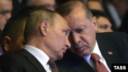 Russian President Vladimir Putin (left) and Turkish President Recep Tayyip Erdogan talk during the 23rd World Energy Congress in Istanbul on October 10.