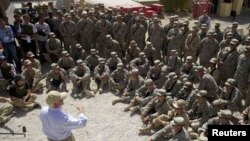 U.S. Secretary of Defense Robert Gates speaks with troops from the 1st Brigade, 4th Infantry Division, as he visits Forward Operation Base Camp Nathan Smith outside Kandahar.