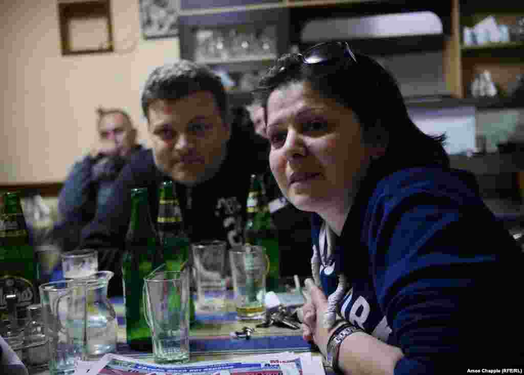 "The discussion gained intensity as the beer flowed. Litsa Chroni runs the taverna and is fearful for the future of her town if the migrants remain stranded in Moria's olive groves. ""It will be the law of the jungle; we will be forced out,"" she said, before adding, ""Just let them leave one church. At least this."""