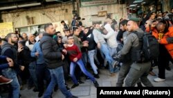 Israeli police and Palestinians scuffle after Friday Prayers in Jerusalem's Old City on December 8.