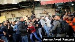 Israeli border policemen and Palestinians scuffle after Friday prayers in Jerusalem's Old City, December 8, 2017