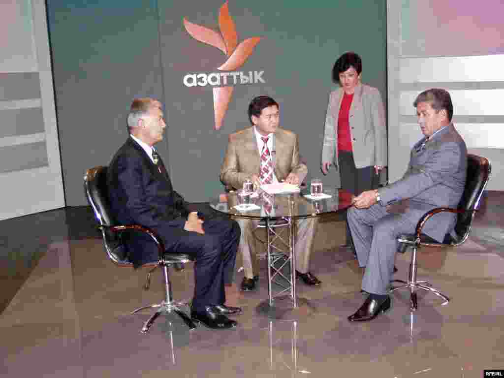 Kyrgyzstan -- Radio Azattyk TV set w/ anchor, guest; CPP (Country Page Photo) for new website for Kyrgyz Service (edited) - Radio Azattyk TV set with host, guest; CPP (Country Page Photo) for new website for Kyrgyz Service