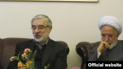 иранские оппозиционные лидеры Мирхоссейн Мусави и Мехди Карруби