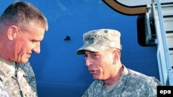 Newly appointed ISAF commander, General David Petraeus (right), talks with Lieutenant General David Rodriguez upon his arrival in Kabul on July 2.