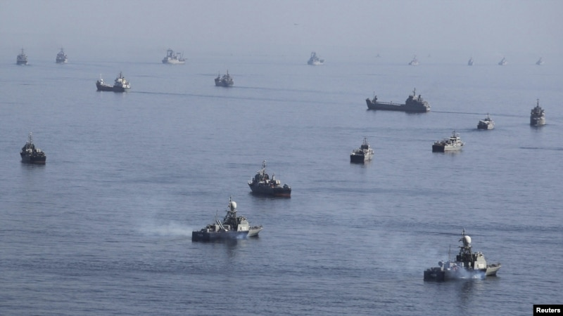 Iranian ships participate in a naval parade during military exercises near the Strait of Hormuz earlier this month.