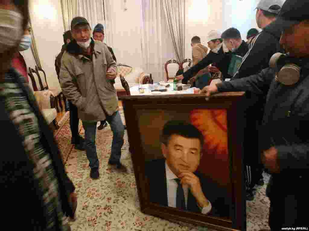 Demonstrators in the Kyrgyz president's office at the White House building, seized by participants in protests against the results of the Kyrgyz parliamentary elections, in Bishkek on October 5.