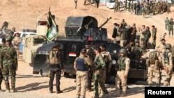 Ирак әскерилері мен күрд жасақтары Дияла провинциясында. Ирак, қараша 2014 жыл.