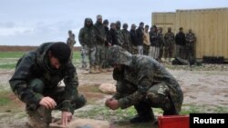 Pamje e ushtarëve afganë në Kampin Shaheen në pjesën veriore të Afganistanit