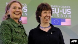 "EU foreign affairs chief Catherine Ashton (shown here with U.S. Secretary of State Hillary Clinton, left) warns that Washington Washington is ""increasingly looking to new partners to address old and new problems."""