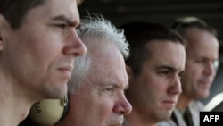 U.S. Secretary of Defense Robert Gates, 2nd from left, watches flight operations aboard the USS Abraham Lincoln in the Arabian Sea on December 6, 2010.