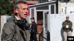 NATO Secretary-General Jens Stoltenberg talks with Italian NATO forces officials in Herat, Afghanistan on November 7, 2014.