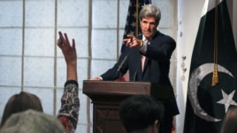 U.S. Senator John Kerry, seen here at a press conference in Pakistan in 2011, has called out Islamabad.