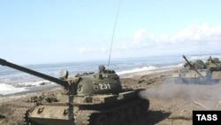Грузия обвинила Россию в военных действиях на своей территории; Россия настаивает, что действует в рамках закона