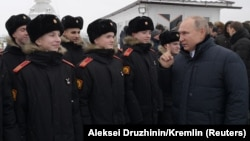 Russian President Vladimir Putin (right) meeting with military cadets last month.