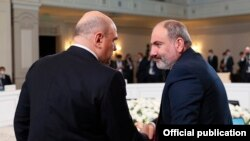 Kazakhstan -- Armenian Prime Minister Nikol Pashinian (R) greets his Russian counterpart Mikhail Mishustin at a Eurasian Economic Union meeting in Almaty, February 5, 2021.