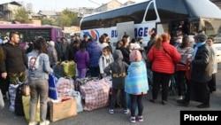 Armenia - Refugees from Nagorno-Karabakh board a bus in Yerevan bound for Stepanakert, November 18, 2020.
