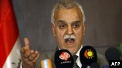Vice President Tariq al-Hashimi speaks at his December 20 press conference in Irbil.