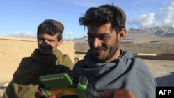 Dutch soldiers gave a radio to these villagers in Afghanistan's southern Uruzgan Province in January.