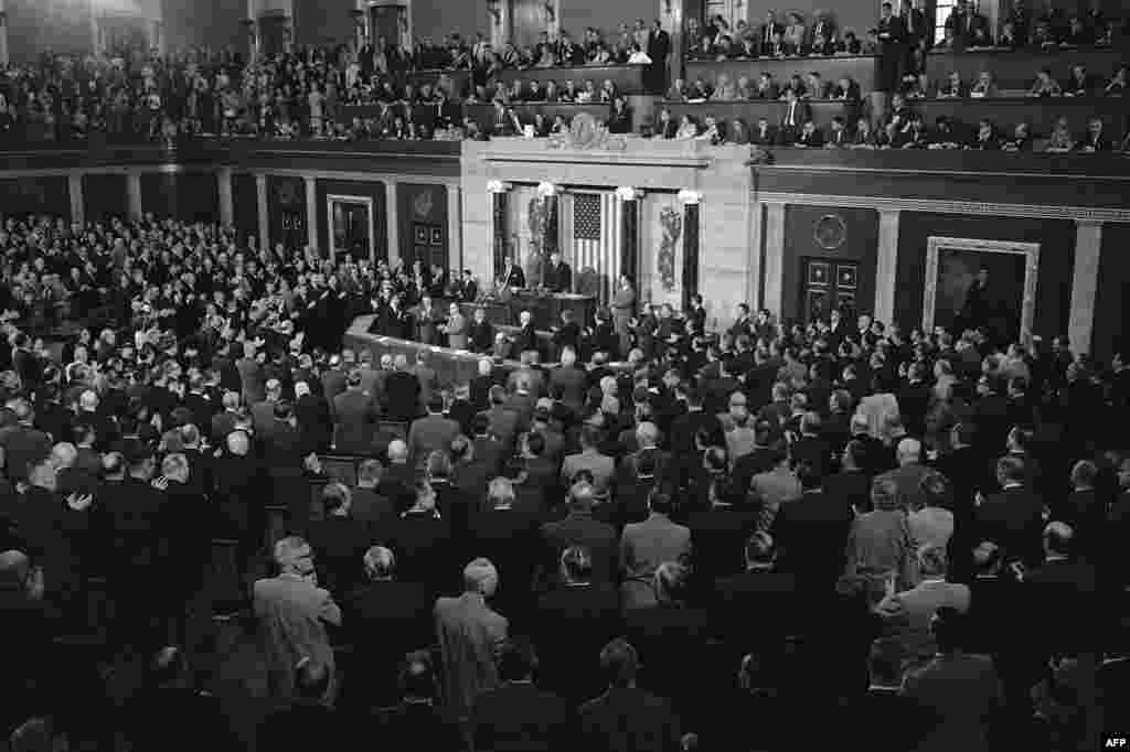 President Kennedy gives a speech to the U.S. Congress on May 26, 1961, asking that lawmakers allocate the money to send the first man to the moon before 1970.